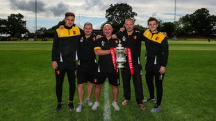 Players from Alvechurch Football Club held the FA Cup trophy.