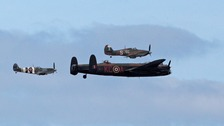 A Lancaster bomber, Spitfire and Hurricane taking part in the Battle of Britain Memorial Flight