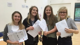 Students at Penistone Grammar School collect their results.
