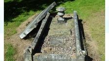 Smashed gravestone