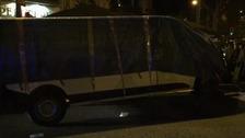 The van is taken away from the scene.