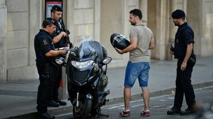 Police check people's documents on Las Ramblas