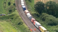 Derailed freight train cleared but rail line still closed until Monday