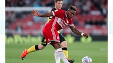 Middlesbrough's Britt Assombalonga battles for the ball.