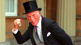 Sir Bruce Forsyth with his OBE in 1998.