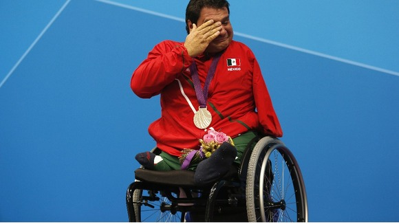 Mexico&#x27;s Arnulfo Castorena wipes his tears after receiving his silver medal for the Men&#x27;s 50m Breaststroke SB2 Final