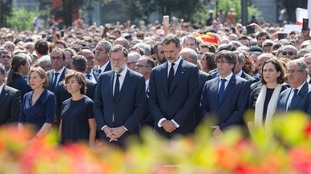 King Felipe VI, Spain's Prime Minister Mariano Rajoy, and other political leaders from Spain's main political parties attend a minute's silence at Placa Catalunya.