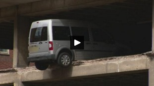 Watch: Car left hanging over edge of car park after part of it collapses