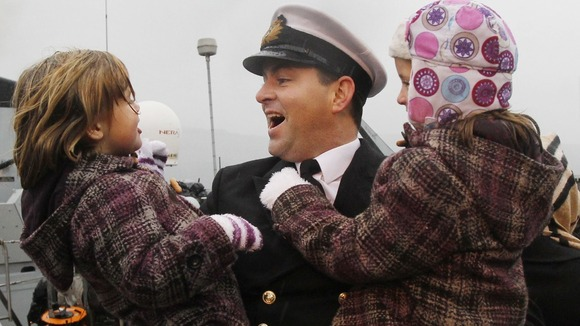 Lieutenant Commander Tim Davey arrives home for Christmas