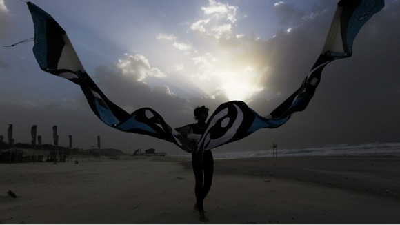 A huge kite flutters in the wind as enthusiasts make the most of the strong gusts on the beach