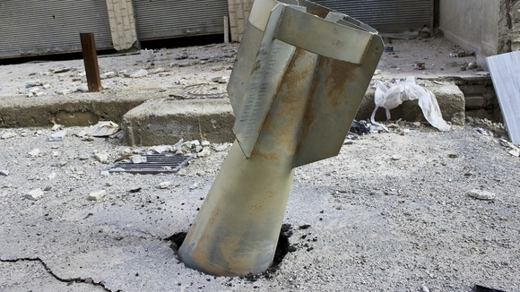 The unexploded bomb trapped in the concrete of the Syrian capital