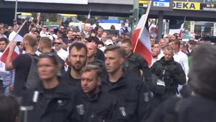 Violence breaks out as neo-Nazis and anti-fascist protesters clash in Berlin