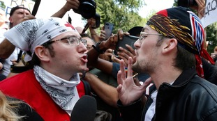 A counter-protester (left) confronts a supporter of Donald Trump.