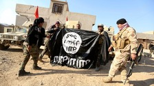 IS fighters told 'surrender or die' as Iraqi raid begins on key city