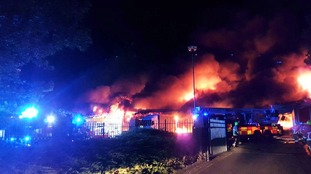 100 firefighters tackle huge warehouse blaze