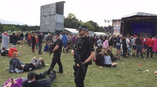 Armed officers can be seen patrolling the site