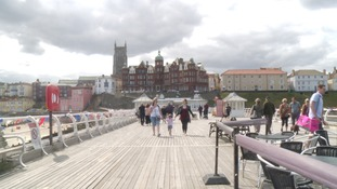 Cromer Pier was open as usual, though closed its bar to the public last night