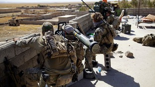 Belgian and US troops take up positions on a rooftop with a guided-missile launcher, a few miles from Tal Afar.