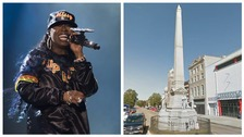 Missy Elliott and a male figure on the Confederate monument.