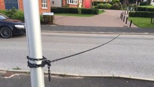 Youths caught tying a chain across a road in Carlisle