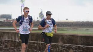 Mark and Harry running alongside the St Aubin's Bay on Saturday.