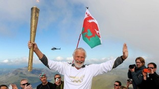 Sir Chris Bonington with the Olympic torch