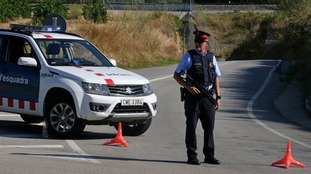 Armed police at the scene in Subirats, 30 miles west of Barcelona.