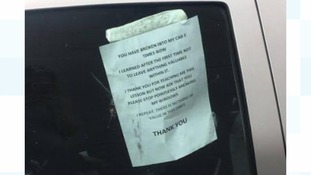 The car owner's letter taped to the window of their car