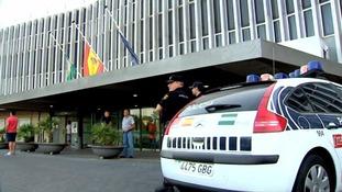 Police outside the Virgen del Valme hospital in Seville.