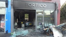 Car smashes through estate agent's front window