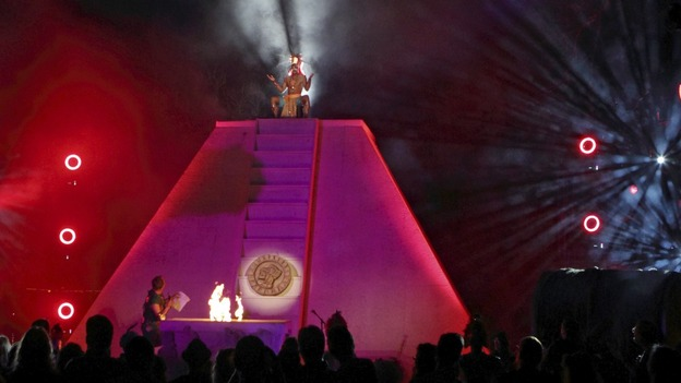 "A Mayan priest sits on top of a pyramid at his ""End of the World Soiree"""