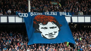 Everton fans hold up a banner reading