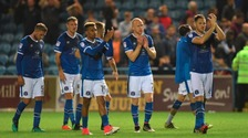 Dejected Carlisle players applaud their fans after being beaten 2-1 by Sunderland.