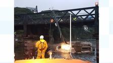 Boat stuck under bridge