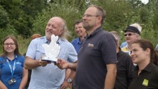 Bill Bailey presented staff and volunteers at the Avalon Wetlands with an environmental award.