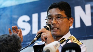 Malaysian Maritime Director Indera Abu Bakar speaks during a press conference about the collision.