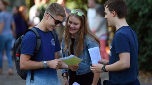 Students celebrate after collecting their GCSE results at Norwich School.