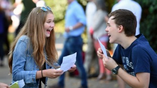 Ella Gant and Tom Moore celebrate after collecting their GCSE results at Norwich School.