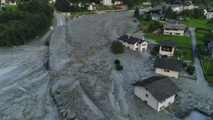 At least eight missing after massive mudslide hits Swiss village