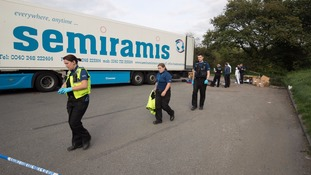 Driver arrested after 13 men found in back of lorry