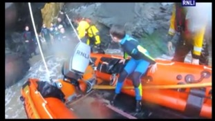 Children rescued after getting cut off by tide