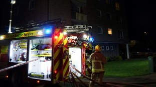 Woman rescued after fire in high-rise block in Bedford