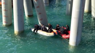 Rescue teams were seen in the water beneath the pier.