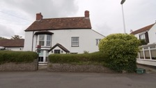 The house and nearly 1 acre garden are valued at £875,000.