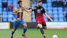 Roberts (left) playing for Shrewsbury Town last season.