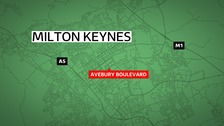 Police in Milton Keynes are trying to track down a BMX biker following an racially aggravated attack on a woman.