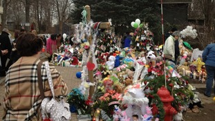 Residents remember those killed a week ago today at Sandy Hook School