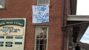 A sign in Sandy Hook reminds people to appreciate their teachers after the school massacre