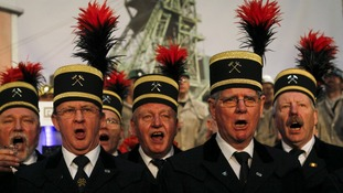 "The miners choir sings ""Der Steiger ruft"" (""the head miner calls"")"