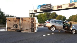 Lanes blocked on M6 Northbound after caravan overturns